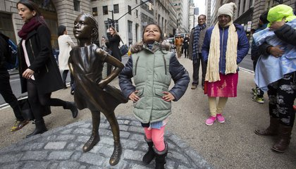 Image: 'Fearless Girl' stares down Wall Street's iconic bull